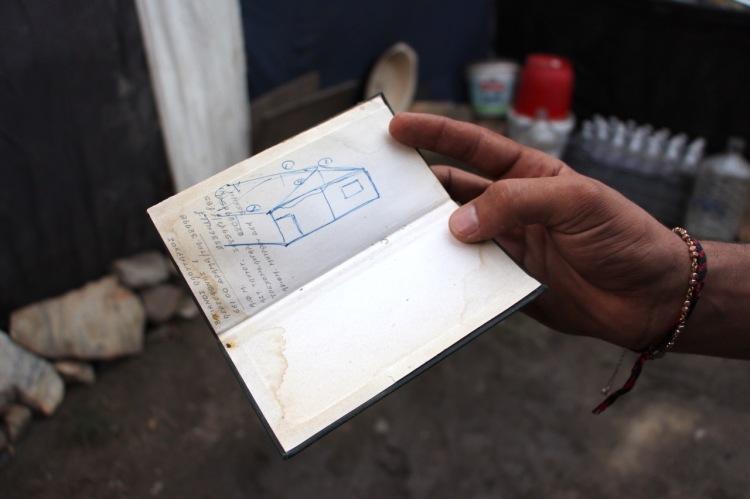 Karams Planung zur Aufbau der Hütte mit einem Zementboden.